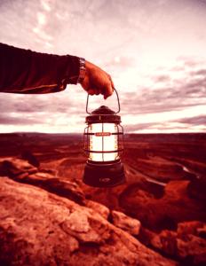 man_holding_a_lantern