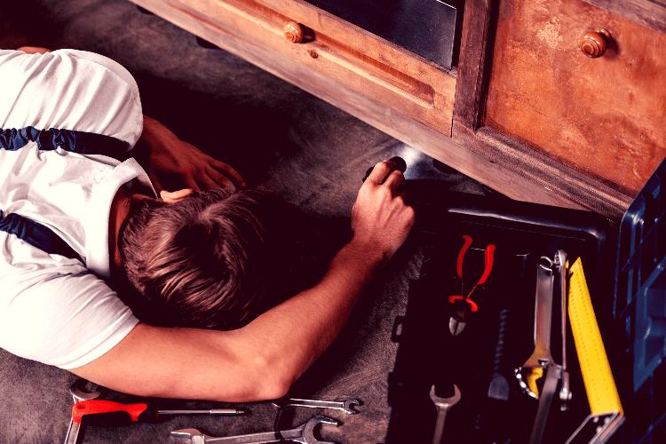 man working under flashlight